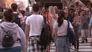 City sidewalk of Times Square with pedestrians slow motion