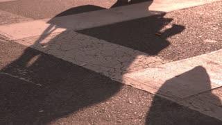 City sidewalk people shadows in slow motion