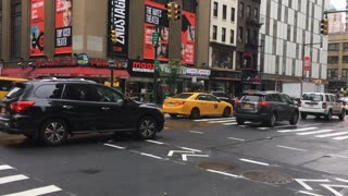City traffic going through downtown on rainy day NYC