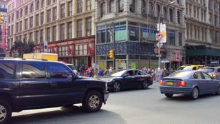 City traffic through intersection in downtown NYC 4k