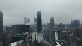 Cloudy and rainy day overview of New York City aerial