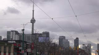 CN Tower over establishing city shot of Toronto Canada 4k