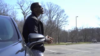 Confident African American male standing against car 4k
