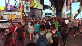Crowded sidewalk with pedestrians in Times Square 4k