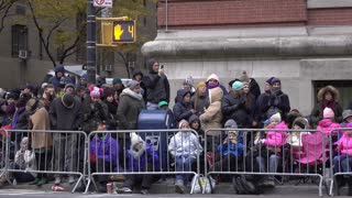 Crowds along parade route fence for 90th Macys 4k