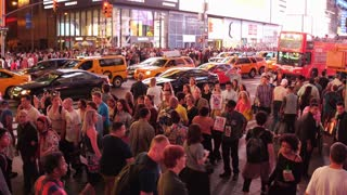 Crowds of pedestrians in Times Square walking down city street 4k