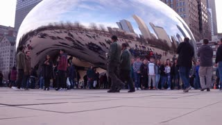 Crowds of people at Cloud Gate in downtown Chicago 4k