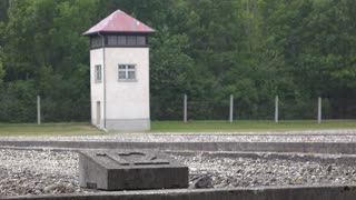 Dachau concentration camp grounds with watch tower 4k
