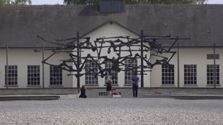 Dachau concentration camp memorial with visitors 4k