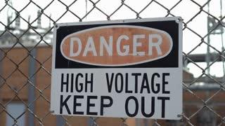 Danger High Voltage Keep Out sign on fence 4k