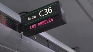 Departure gate sign for Los Angeles at airport 4k