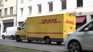 DHL delivery truck dropping off packages in Munich Germany 4k