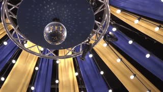 Disco ball rotating in circus tent 4k