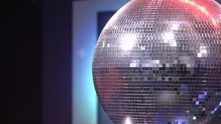Disco ball with shiny light reflecting 4k