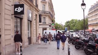 DJI store exterior establishing shot in Paris France 4k