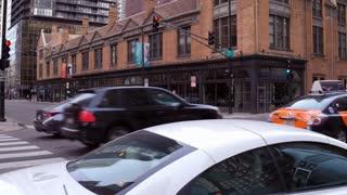Downtown Chicago traffic establishing shot to city buildings 4k