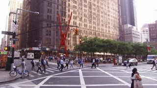Downtown city of New York with pedestrians crossing streets