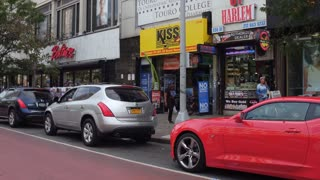 Driving through downtown Harlem store fronts 4k