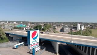 Establishing aerial shot of Pepsi sign in downtown Dayton Ohio