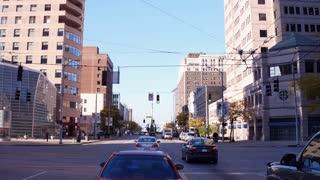 Establishing driving through small city shot of Dayton Ohio 4k