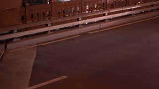 Establishing night exterior of city traffic tilt shot in NYC 4k