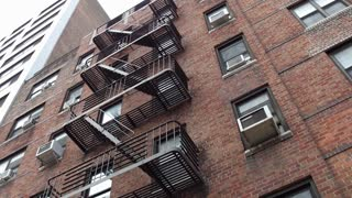 Establishing of exterior typical apartment building in NYC 4k