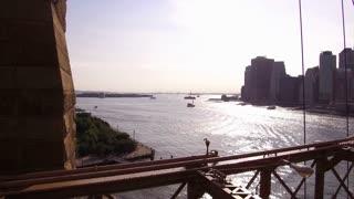 Establishing pan shot of NYC from Brooklyn Bridge