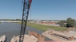 Establishing shot of crane at construction site aerial view