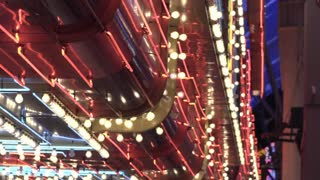 Establishing shot of flashing casino lights exterior building 4k