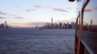 Establishing shot of New York City coming in by ship 4k