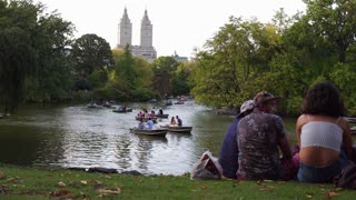 Establishing shot of people relaxing in Central Park NYC 4k