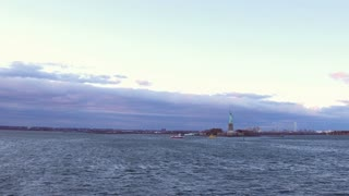 Establishing shot of Statue of Liberty out in water 4k