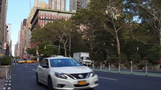 Establishing shot of typical Manhattan city street traffic 4k