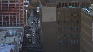 Establishing tilt shot of New York City streets traffic from above 4k