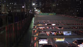 Evening traffic of cars and pedestrians crossing Brooklyn Bridge 4k