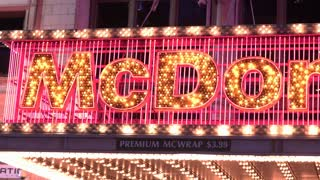 Exterior McDonalds flashing light marquee in New York 4k