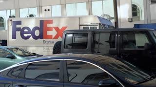 Fedex truck in traffic downtown St Louis
