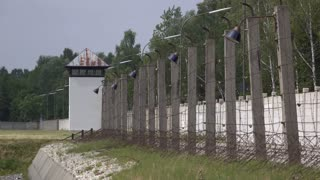 Fenced in prison yard with watch tower 4k