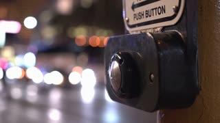 Finger pressing crosswalk signal button at night 4k