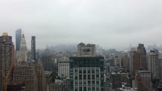 Fog over New York City on rainy day