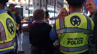 Friendly police officer chatting with Hermes Parade visitors 4k