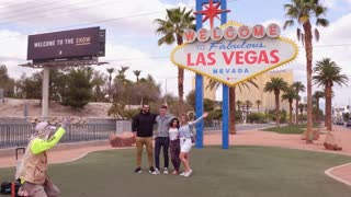 Friends posing at Welcome to Las Vegas sign 4k
