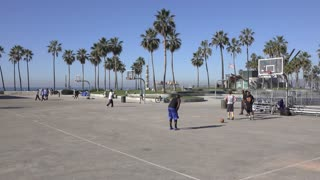 Game of street basketball at court in Venice Beach California 4k