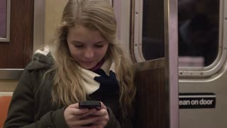 Girl on train commute using her cell phone to text 4k