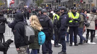 Group of NYPD officers with crowd of people from Macys Parade 4k