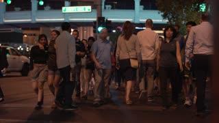 Group of people crossing Las Vegas street at night 4k