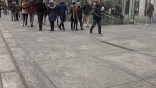 Groups of people entering Apple store NYC tilt shot 4k