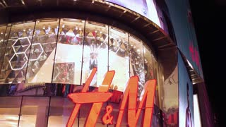 H & M clothing store front in Times Square NYC at night 4k