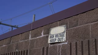 High Voltage Keep out sign with electrical wires above 4k