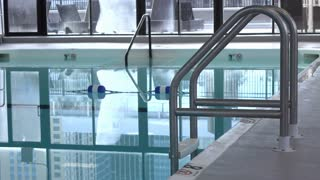 Indoor hotel swimming pool with water ripples 4k